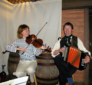 Sharon and Tim performing on board ship...